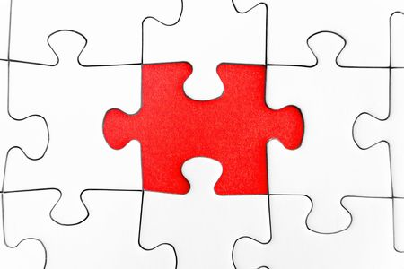 Missing jigsaw piece in a blank puzzle.
