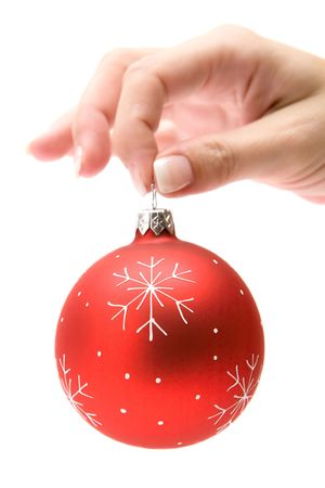Female hand holding a red Christmas bauble. Isolated on a white background. Stock Photo - 2097669