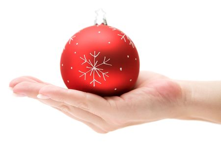 Female hand presenting a red Christmas tree ball. Isolated on a white background. Stock Photo - 2097638