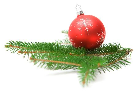 Christmas tree ball sitting on a green fir branch. White background. Stock Photo - 2097673
