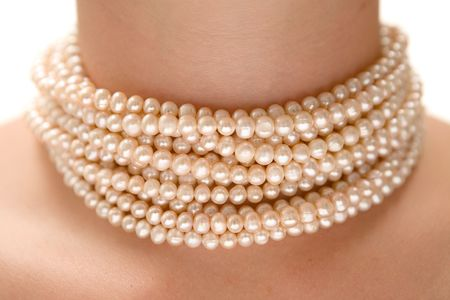 pearl necklace: Precious pearls on a womans neck. White background.