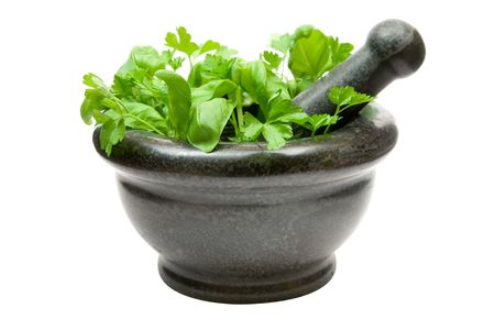 Basil and mint in a stone mortar. Isolated on a white background. photo