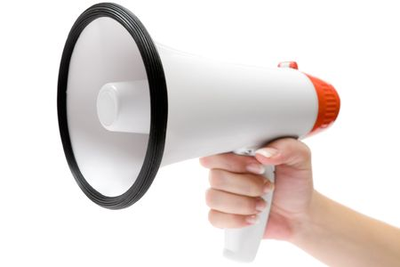 bellowing: Female hand and megaphone. Isolated on a white background.
