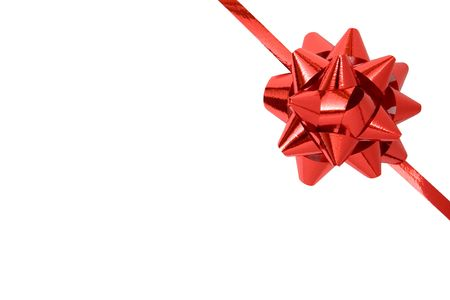Red ribbon and bow isolated on a white background.