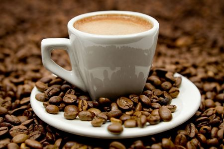 Hot beverage on coffee beans.
