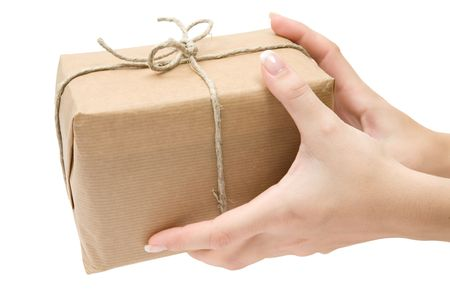 pack string: Female hands holding a brown parcel. Isolated on a white background.
