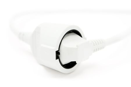 plugged: Plugged extension cable. Shallow depth of field. White background.