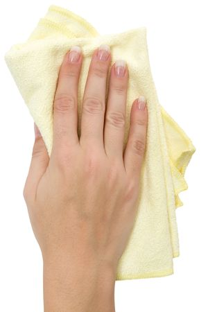 Female hand wiping with a yellow rag. Isolated on a white background. photo