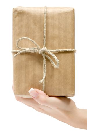 Presenting a brown packet. Isolated on a white background.