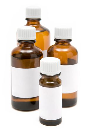 Several medicine bottles with blank labels isolated on a white background.