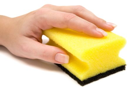 Female hand holding a yellow cleaning sponge. White background.