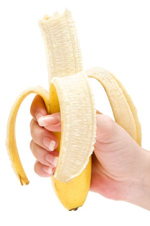ailment: Female hand holding a peeled banana. Isolated on a white background.