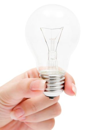 Woman holding a light bulb. Isolated on a white background.