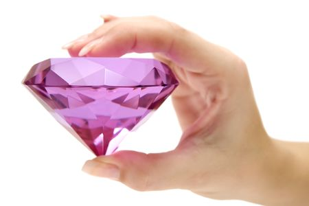 prism: Female hand holding a precious gem. Isolated on a white background. Stock Photo