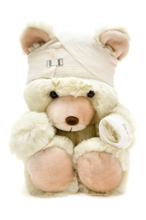 bandage: Wounded teddy bear. Isolated on a white background.