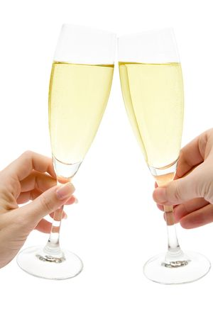 Man and woman celebrating with two glasses of champagne. Isolated on a white background. Stock Photo