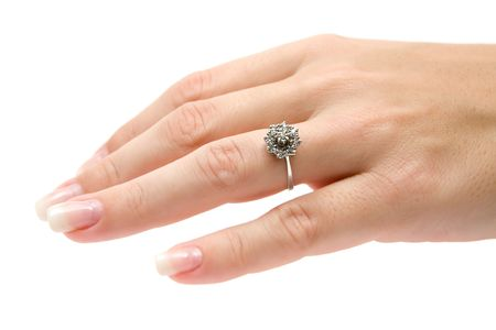 engagement ring: Wearing a precious diamond ring. Isolated on a white background.