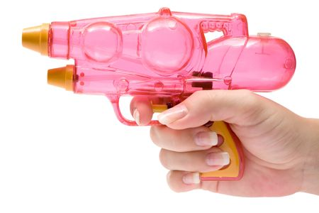 Woman holding a pink water pistol. Isolated on a white background. photo