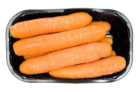 aliments: Bunch of carrots in a black box. Isolated on a white background. Stock Photo