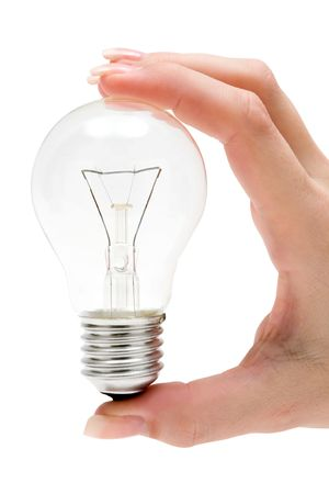 Holding a light bulb. Isolated on a white background. photo