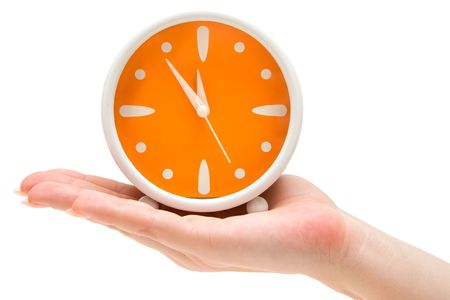 Woman holding an orange alarm clock. Isolated on a white background.