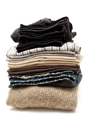 white pants: Stack of various clothes. White background.