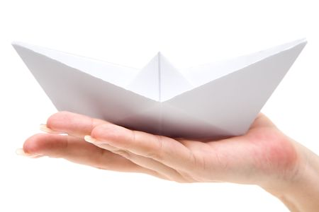 small paper: Woman holding a folded paper boat. Isolated on a white background.
