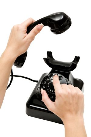 dialing: Marcar un n�mero de tel�fono. Aislada en un fondo blanco.  Foto de archivo