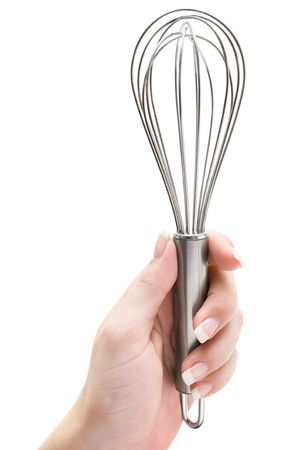 Woman holding a wire whisk. Isolated on a white background. photo