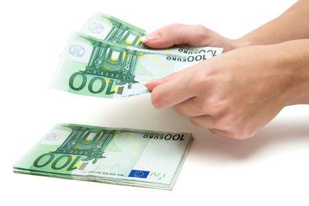 Woman stacking Euro banknotes. White background. Stock Photo - 2783248