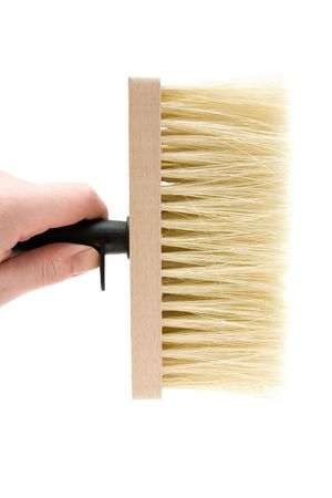 Holding a big brush. Isolated on a white background. photo