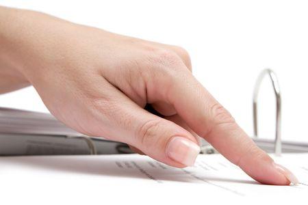 집게 손가락: Female forefinger pointing at a business document in a file folder. White background.