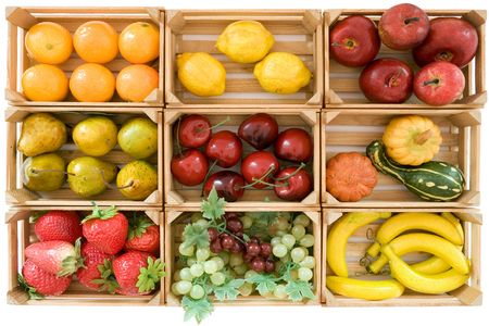 Wooden baskets with various toy fruits. Isolated on a white background.