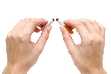 banning the symbol: Woman breaking a cigarette. Isolated on a white background.