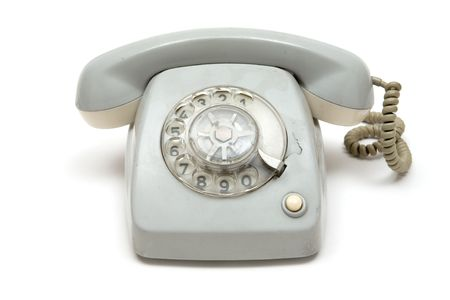 Broken dirty phone. White background. photo