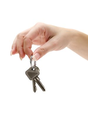Female hand holding keys. Isolated on a white background.