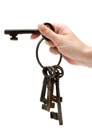 hand key: Female hand holding a bunch of rusty old keys. Isolated on a white background.