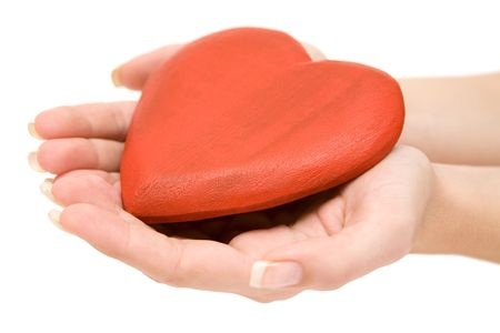 Woman holding a wooden heart in her hands. Isolated on a white background. photo