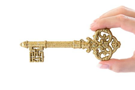 Woman holding a precious key. Isolated on a white background. photo