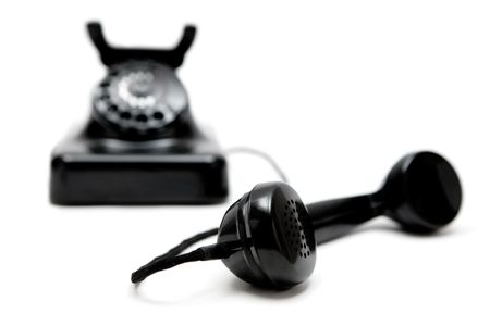Old phone. White background. Shallow depth of field. Stock Photo
