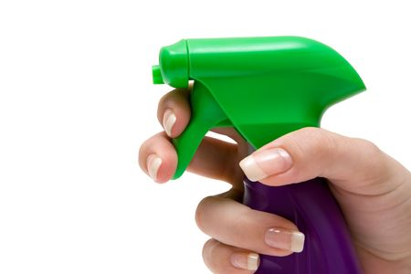 Woman using a spray bottle. Isolated on a white background. photo