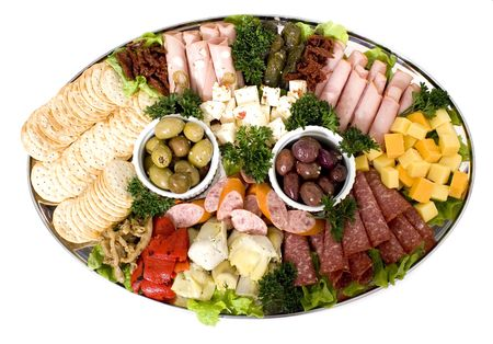 An antipasto catering platter of continental meats and vegetables