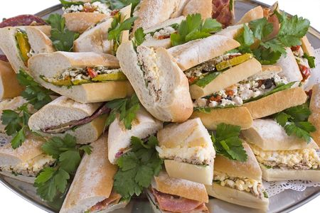 platters: Catering platter of assorted sandwich baguettes, cut and arranged on a platter