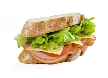 Sliced virginian ham sandwich on gourmet multi-grain bread together with tomatoes, cheese and lettuce photo
