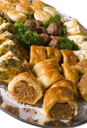 party tray: Platter of hot party pies, sausage rolls, quiche and savoury meatballs on a silver catering platter