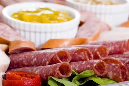 wholegrain mustard: Close up sliced salami on a cold meat catering platter