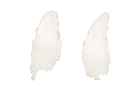 White cream swatches isolated on white background. Face cream lotion samples texture. Beauty lotion stroke on white. 版權商用圖片