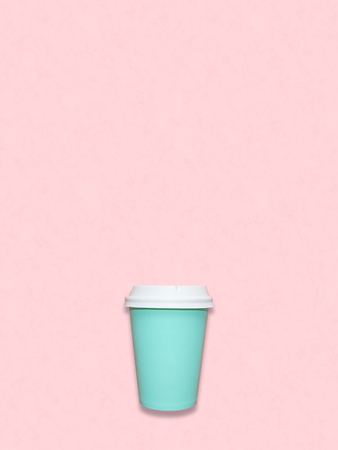 Take away coffee cup on pink marble table, top view. Turquoise and pink trendy colors, bright flat lay background with space for text. Colourful coffee background.