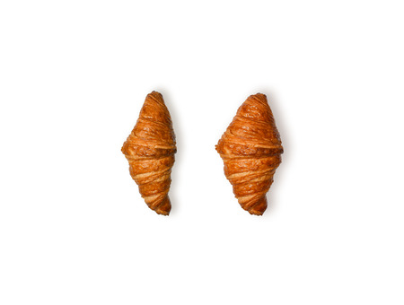 Fresh croissant isolated on white background, top view. Home made bakery pastry set.