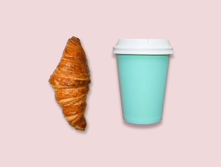 Take away coffee cup and croissant on pink table, top view. Turquoise and pink trendy colors, fresh home made pastry, bright flat lay background with space for text. Banque d'images